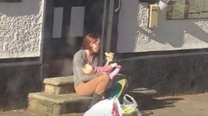 The original photo of Emily Slough, feeding her baby.